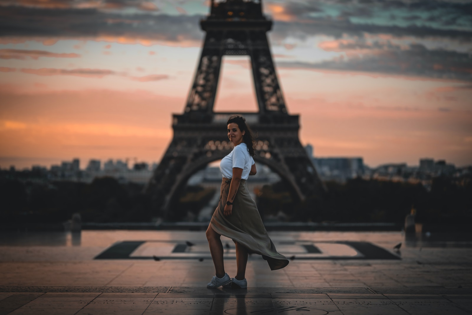 Selective Focus Photography Of Woman Standing In Front Of Eiffel Tower, Paris